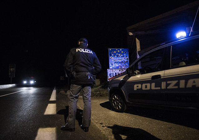 An Italian police officers newly dispatched at the border stands guard on the Italian side late on October 20, 2018 at the Italian - French border in the Alpine border town of Claviere, some 100 kilometers west of Turin.