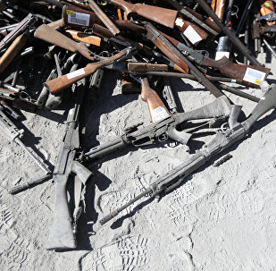 Confiscated weapons are seen before being destroyed