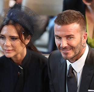 David and Victoria Beckham take their seats in St George's Chapel before the wedding ceremony of Britain's Prince Harry, Duke of Sussex and US actress Meghan Markle in St George's Chapel, Windsor Castle, in Windsor, on May 19, 2018.