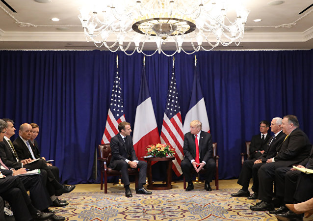 US Secretary of State Mike Pompeo (2nd from R), US Vice President Mike Pence (3rd from R) listen to French President Emmanuel Macron (center L) talks with US President Donald Trump during a bilateral meeting in New York on September 24, 2018, a day before the start of the General Debate of the 73rd session of the General Assembly
