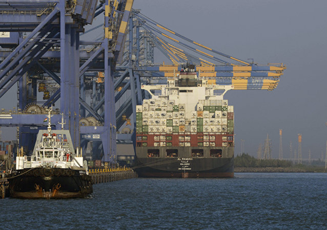 A container ship (R) docked at India's Adani Port Special Economic Zone (APSEZ) in Mundra (File)