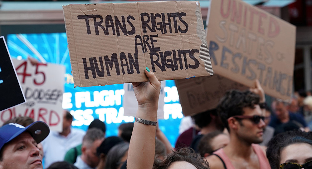 People protest U.S. President Donald Trump's announcement that he plans to reinstate a ban on transgender individuals from serving in any capacity in the U.S. military, in Times Square, in New York City, New York, U.S (File)