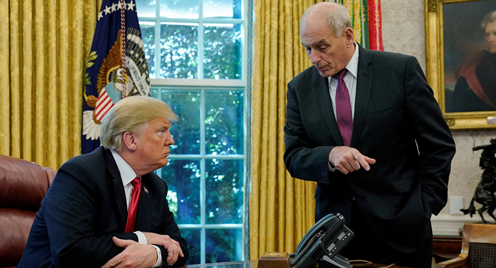 U.S. President Donald Trump speaks to White House Chief of Staff John Kelly after an event with reporters in the Oval Office at the White House in Washington, U.S. October 10, 2018