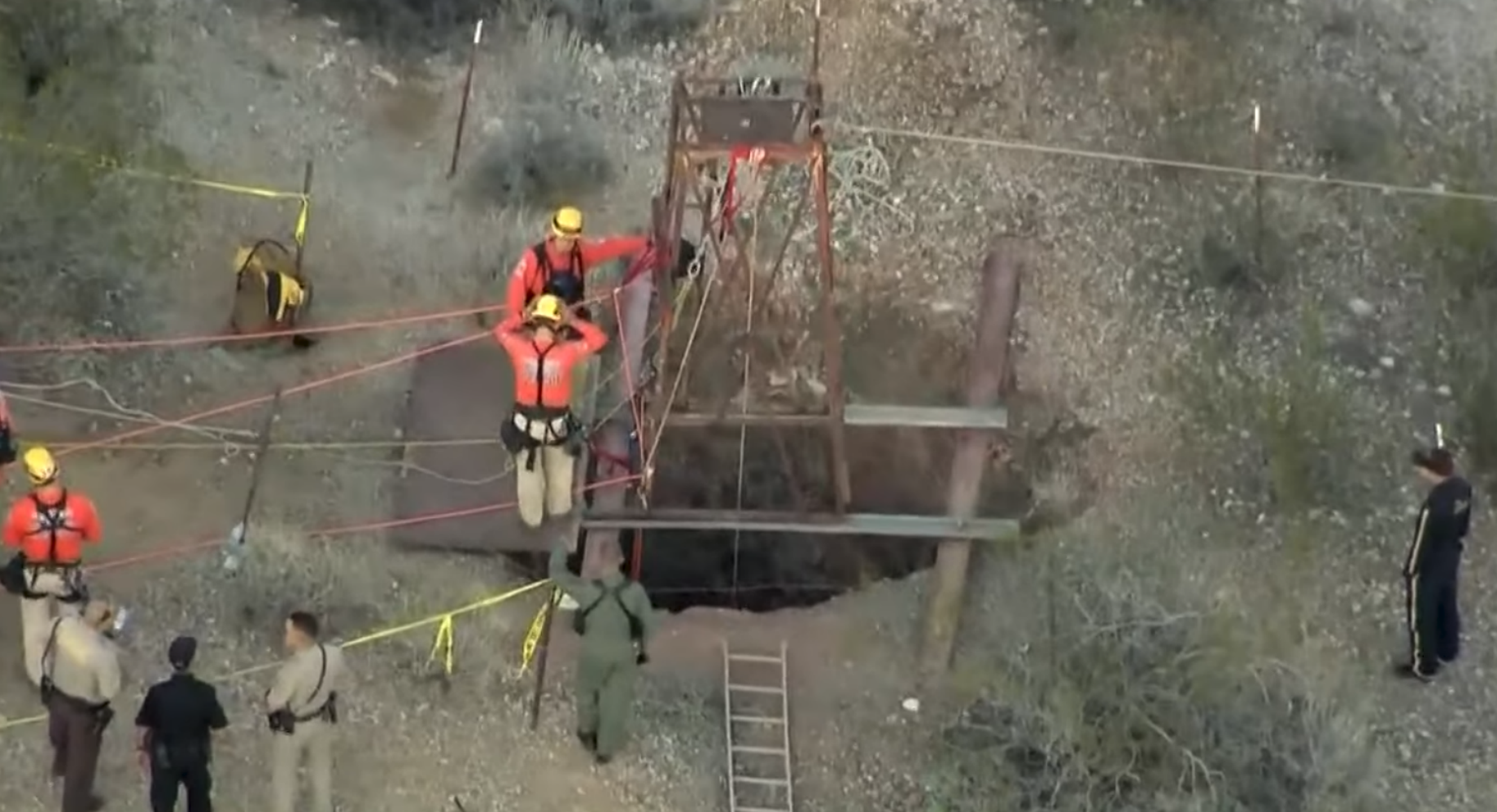 Emergency responders work to rescue amatuer prospector John Waddell from mine shaft