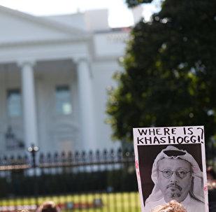 An activist holds an image of missing Saudi journalist Jamal Khashoggi during a demonstration calling for sanctions against Saudi Arabia