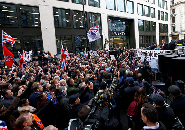 Far right activist Stephen Yaxley-Lennon, who goes by the name Tommy Robinson, speaks to supporters as he arrives to face contempt of court charges at the Old Bailey in London, Britain, October 23, 2018