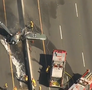 Plane crashes on southern California highway.
