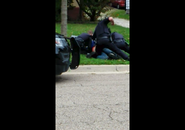 Akron Police Department launch use-of-force investigation after video emerges, showing officer punch suspect more than 30 times.