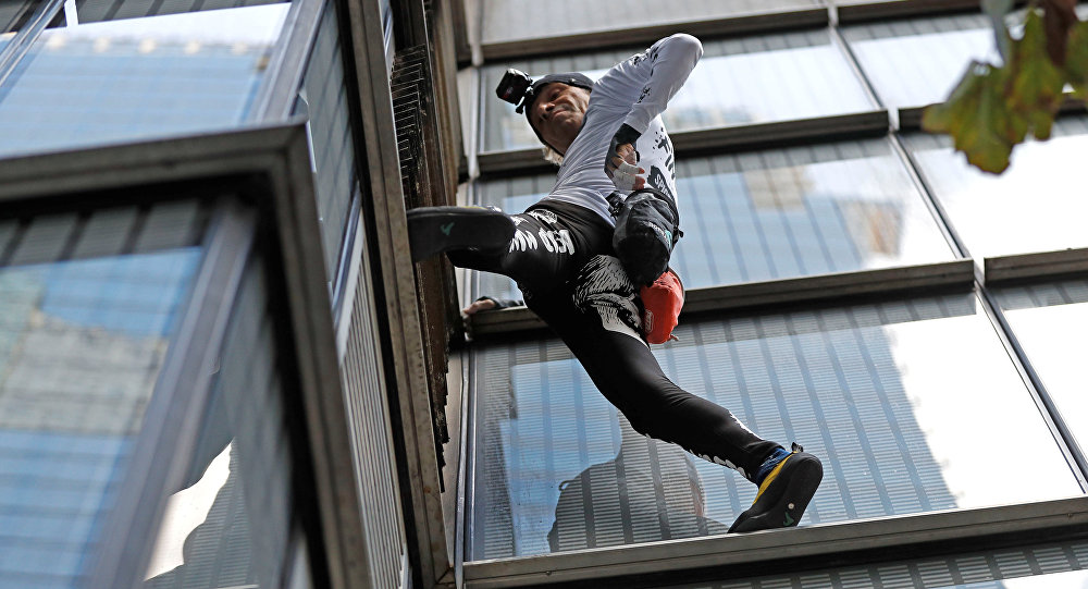 French free-climber Alain Robert, known as 'Spiderman', attempts to climb up the outside of the Heron Tower in the financial district of London, Britain, October 25, 2018