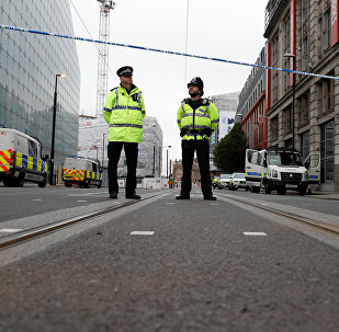 Police stand in the vicinity of Manchester arena