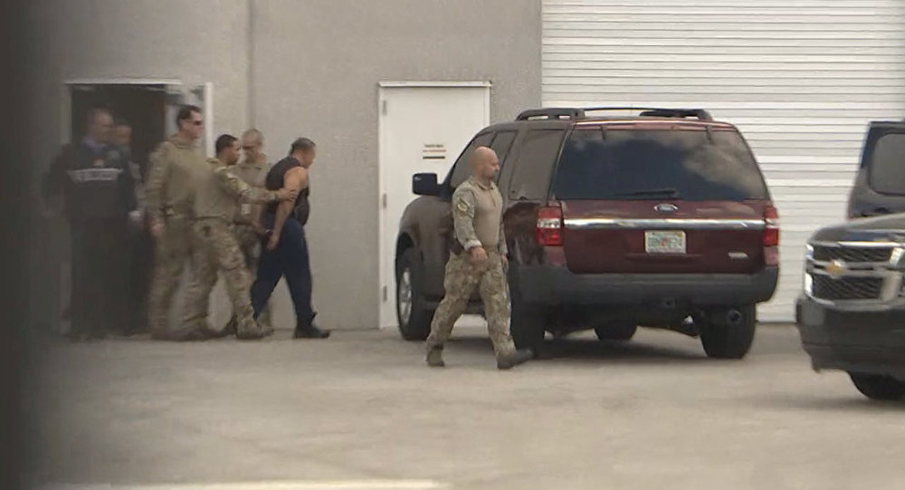 FBI officers escort Cesar Altieri Sayoc into a waiting SUV at FBI headquarters after arresting him in connection with an investigation into a string of parcel bombs, in Miramar, Florida, U.S. October 26, 2018.