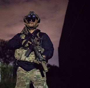 An agent with the U.S. Border Patrol Tactical Unit guards the U.S. side of the border wall with Mexico in Brownsville, Texas, U.S.