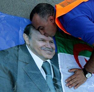 A supporter of Algerian President Abdelaziz Bouteflika