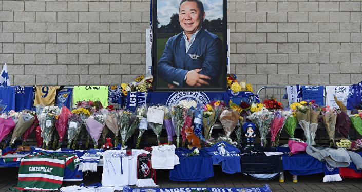A portrait of Leicester City Football Club's Thai chairman Vichai Srivaddhanaprabha, who died in a helicopter crash at the club's stadium, is seen amid flowers and tributes outside the King Power Stadium in Leicester, eastern England, on October 29, 2018