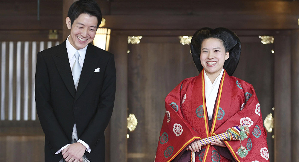 Japanese Princess Ayako (R) and her husband Kei Moriya answer reporters' questions after their wedding ceremony at the Meiji Shrine in Tokyo, Japan, in this photo released by Kyodo on October 29, 2018.