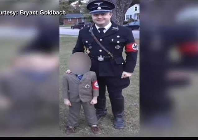 Bryant Goldbach of Owensboro, Kentucky wears a Nazi soldier-style costume for Halloween with his son, 5, dressed as Adolf Hitler.