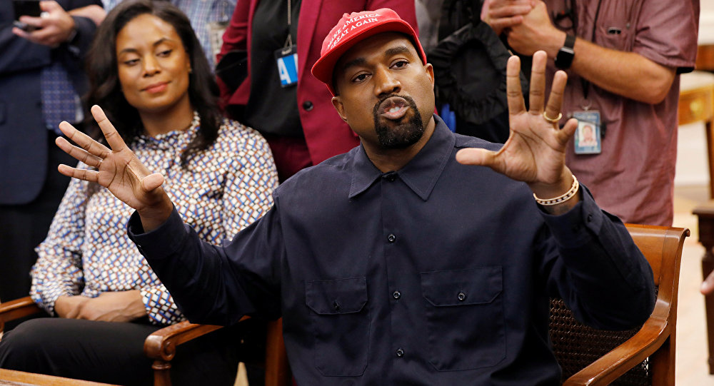 Rapper Kanye West speaks as he sits next to Monique Brown (L), wife of NFL Hall of Fame player Jim Brown, during a meeting with U.S. President Donald Trump in the Oval Office at the White House in Washington, U.S., October 11, 2018