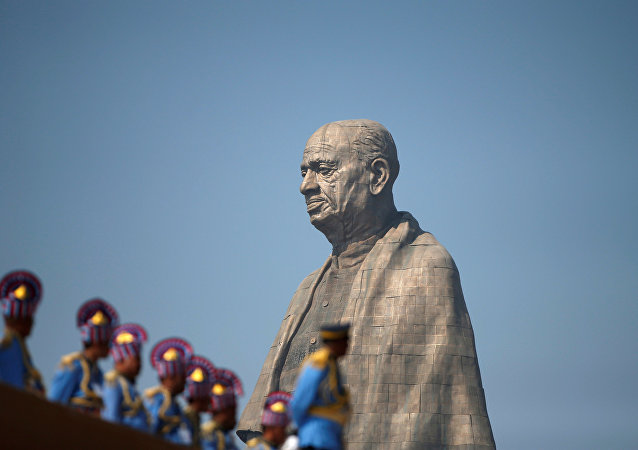 Police officers stand near the Statue of Unity portraying Sardar Vallabhbhai Patel, one of the founding fathers of India, during its inauguration in Kevadia, in the western state of Gujarat, India, October 31, 2018