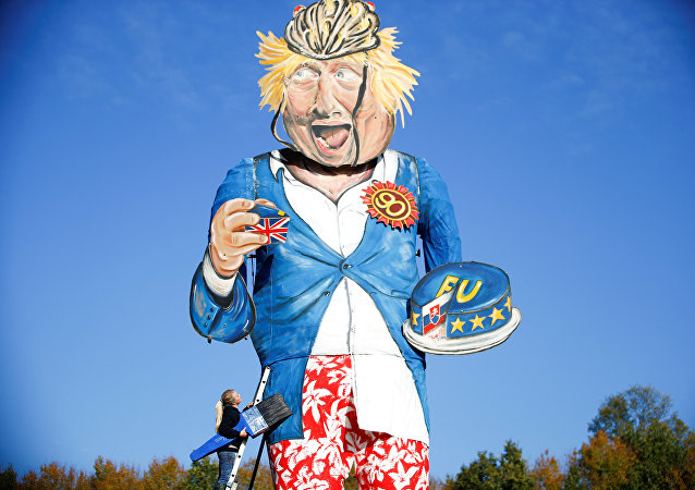 Artist Andrea Deans poses with the 11-metre effigy of Boris Johnson unveiled today ahead of the Edenbridge Bonfire Celebrations in Edenbridge, Britain October 31, 2018.