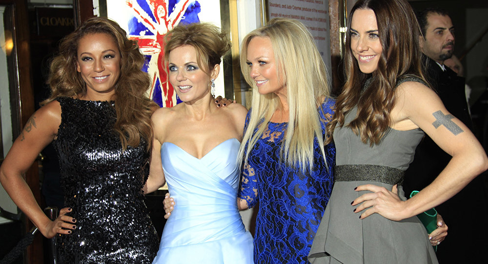 From left, Mel B, Geri Halliwell, Emma Bunton and Mel C arrive for Viva Forever! Press Night, a musical based on the songs of the Spice Girls, at the Piccadilly Theatre in central London, Tuesday, Dec. 11, 2012.