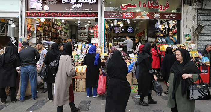Iranians shop at the grand bazar in the capital Tehran on November 3, 2018