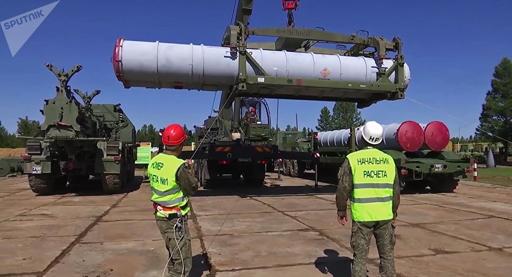 Military personel load missile into S-300 air defense missile system during exercises of the Air Defence Forces, as part of Vostok-2018 (East-2018) military drills, in Chukotka Region, Russia, September 12, 2018