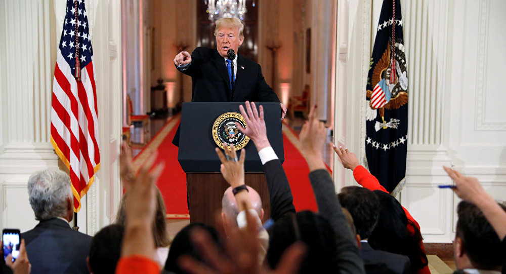 U.S. President Donald Trump points to a questioner while taking questions during a news conference following Tuesday's midterm congressional elections at the White House in Washington, U.S., November 7, 2018