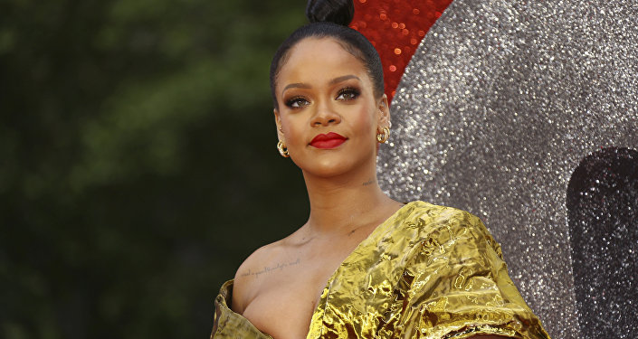 Rihanna poses for photographers upon arrival at the premiere of the film 'Ocean's 8' in central London, Wednesday, June 13, 2018