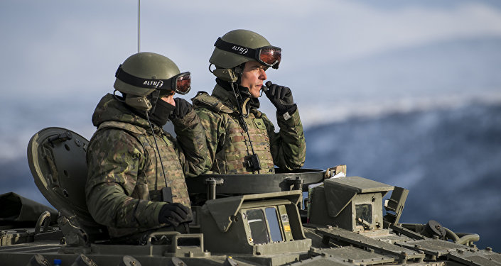 Spanish soldiers in an Pizarro tank during an exercise to capture an airfield as part of the Trident Juncture 2018, a NATO-led military exercise, on November 1, 2018 near the town of Oppdal, Norway.