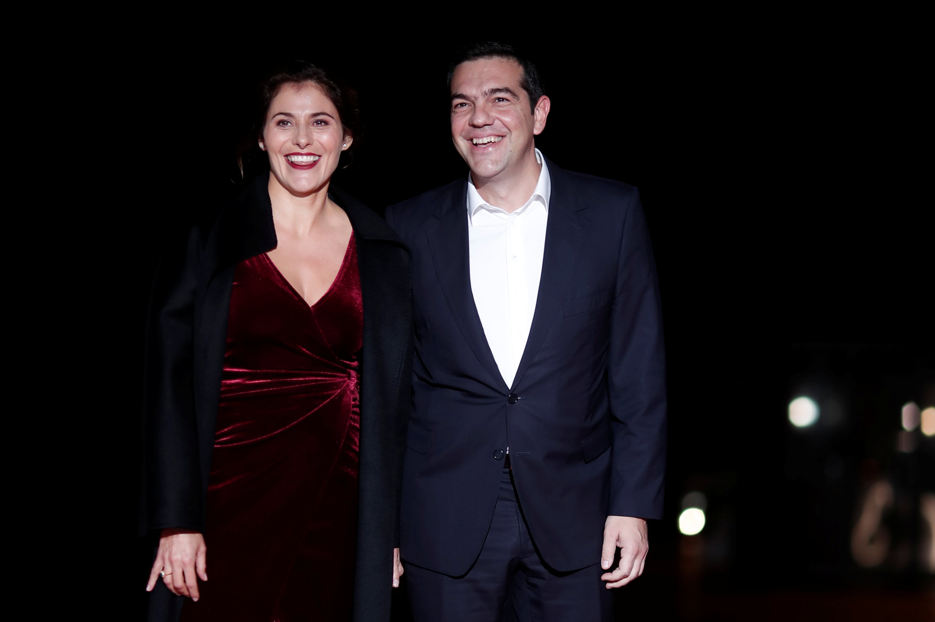 Greek Prime Minister Alexis Tsipras and his partner Peristera Baziana arrive to attend a visit and a dinner at the Orsay Museum in Paris