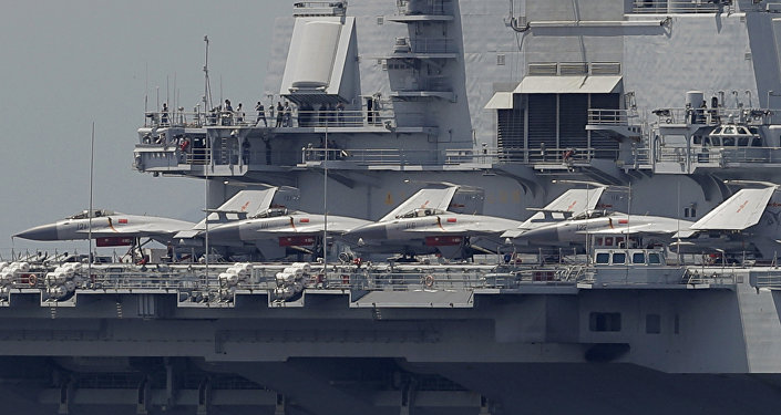 The Liaoning, China's first aircraft carrier, departs Hong Kong