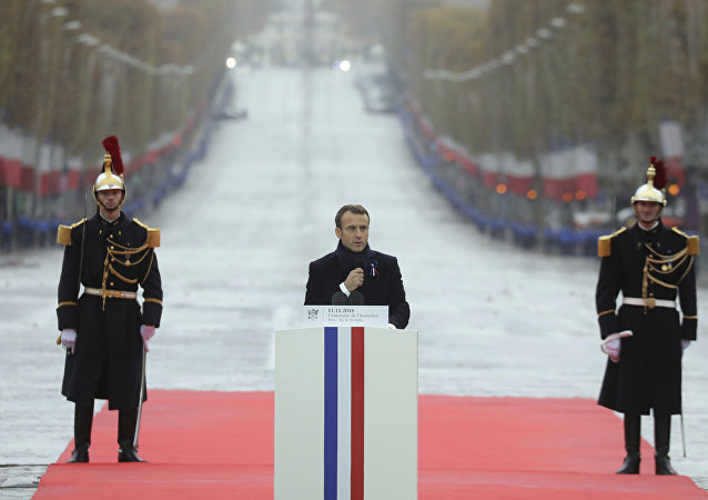 French President Emmanuel Macron delivers a speech during a ceremony at the Arc de Triomphe in Paris as part of the commemorations marking the 100th anniversary of the 11 November 1918 armistice, ending World War I, Sunday, Nov. 11, 2018