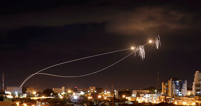 Israeli Iron Dome anti-missile system fires interception missiles