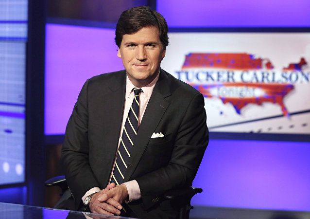 Tucker Carlson, host of Tucker Carlson Tonight, poses for photos in a Fox News Channel studio, in New York, Thursday, March 2, 2107.