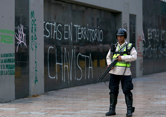 A Bolivarian National Police officer stands on guard
