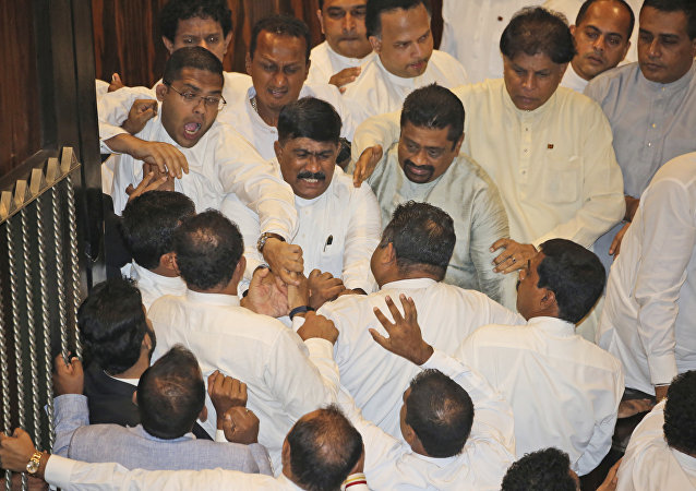 Sri Lankan Lawmakers fight in the parliament chamber in Colombo, Sri Lanka, November 15, 2018