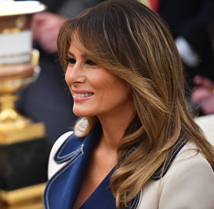 US First Lady Melania Trump smiles as US President Donald Trump and Polish President Andrzej Duda speak to the media in the Oval office at the White House on September 18, 2018 in Washington,DC.