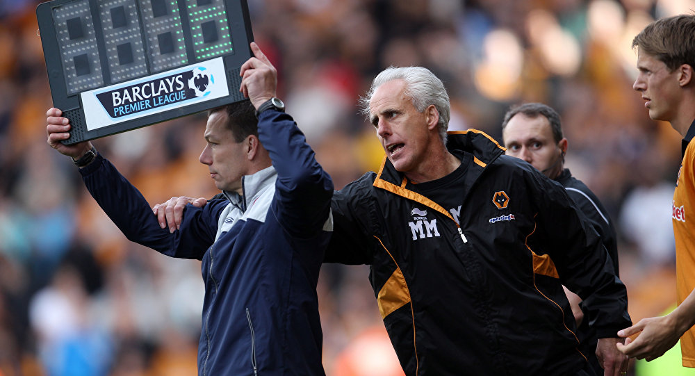Wolves manager Mick McCarthy tries to stop a substitution during a Premier League match