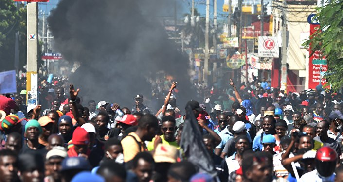 Demonstrators march during a protest demanding accountability from politicians for allegedly squandering billions of dollars in proceeds from Venezuela's discounted PetroCaribe oil program in the streets of Port-au-Prince, on November 18, 2018, Investigations by the Haitian Senate in 2016 and 2017 concluded that nearly $2 billion from a Venezuelan aid program called Petrocaribe were misused. Through Petrocaribe, Venezuela for years supplied Haiti and other Caribbean and Central American countries with oil at cut-rate prices and on easy credit terms.