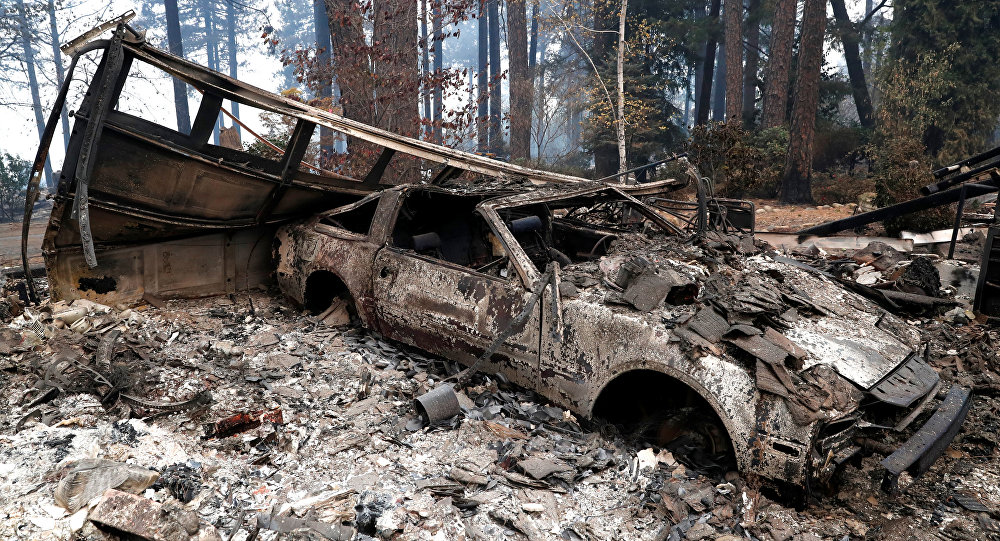 A car destroyed by the Camp Fire is seen in Paradise, California