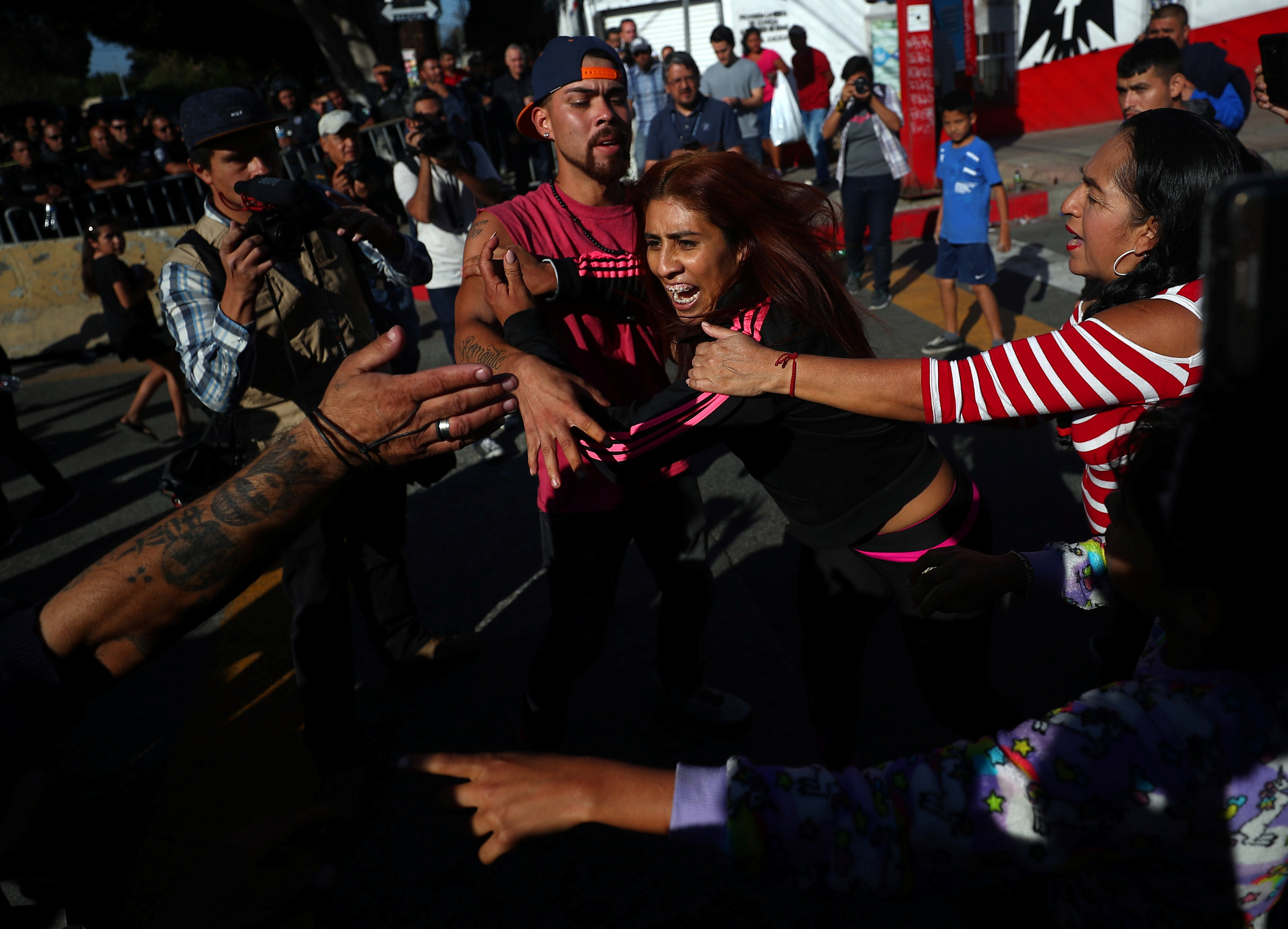 Demonstrators clash during a protest against migrants from Central America in Tijuana.