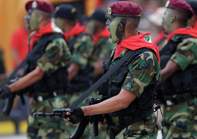 Soldiers march during a military parade in Caracas