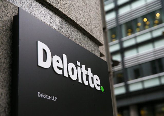 A Deloitte logo is pictured on a sign outside the company's offices in London on September 25, 2017