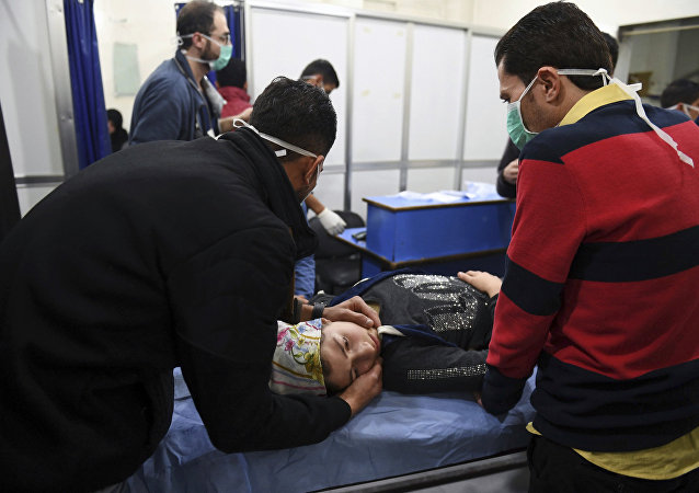 In this photo released by the Syrian official news agency SANA, a woman receives treatment at a hospital following a suspected poison gas attack on her town of al-Khalidiya, in Aleppo, Syria, Saturday, Nov. 24, 2018.