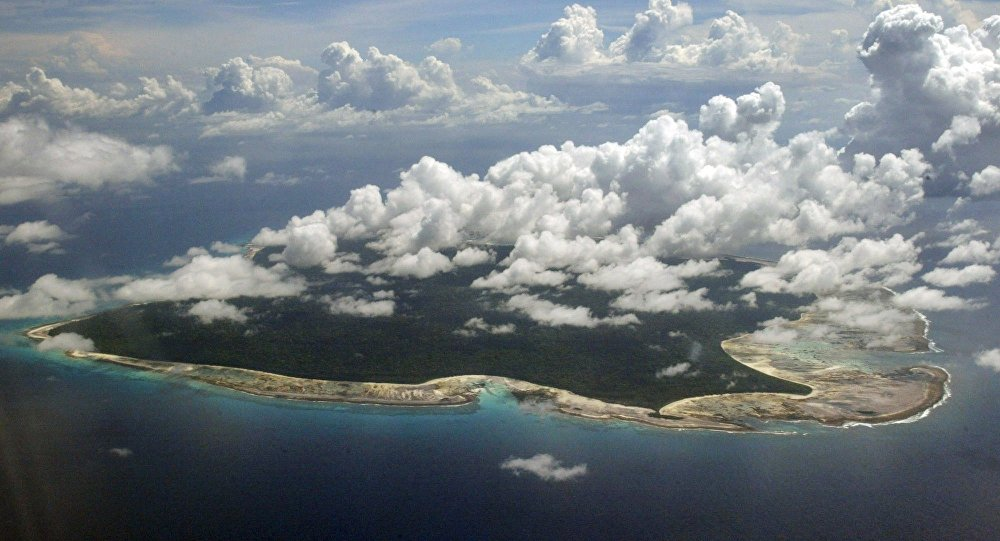 In this Nov. 14, 2005 file photo, clouds hang over the North Sentinel Island, in India's southeastern Andaman and Nicobar Islands. An American is believed to have been killed by an isolated Indian island tribe known to fire at outsiders with bows and arrows, Indian police said Wednesday, Nov. 21, 2018.