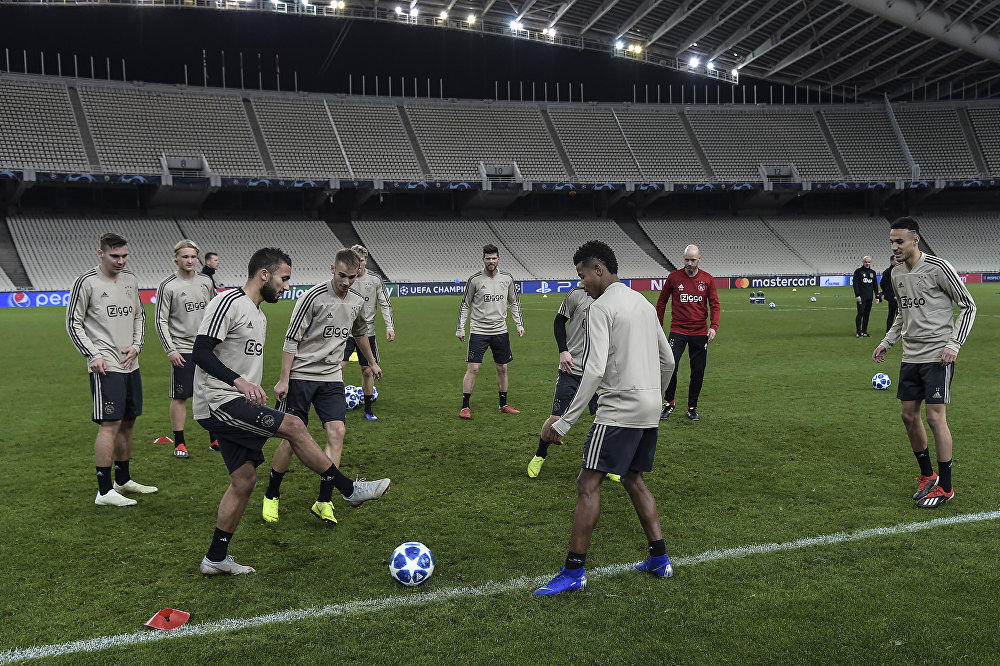 Ajax players training on the pitch at the Olympic Stadium ahead of the match with AEK Athens