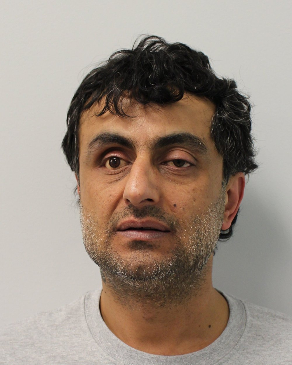 Rahim Mohammadi (pictured) was an asylum seeker from Iran who spent much of his time smoking opium in his shed