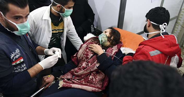 A Syrian woman receives treatment at a hospital in the regime controlled Aleppo on November 24, 2018