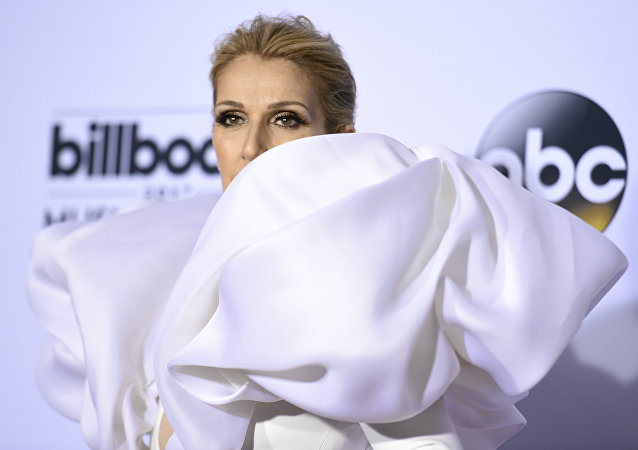 Celine Dion poses in the press room at the Billboard Music Awards at the T-Mobile Arena on Sunday, May 21, 2017, in Las Vegas.