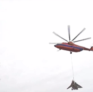 Mi-26 carrying Su-24.